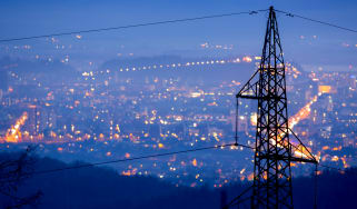 Power lines set against a city at night
