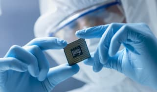 A chip technician examining a semiconductor chip