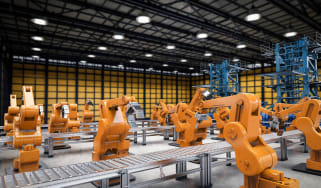 Interiors of a modern factory with orange robots