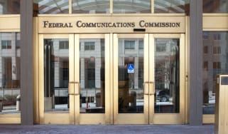 The Federal Communications Commission (FCC) logo on a building