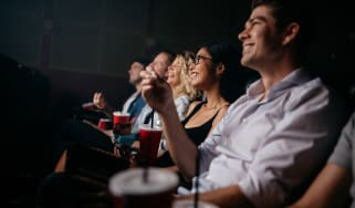 People watching a film in a cinema