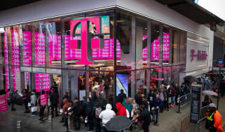 Customers line up outside a T-Mobile store