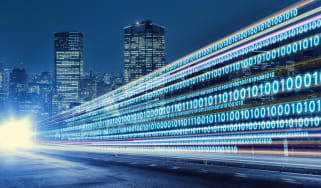 Ones and zeroes rushing through a city to represent data movement