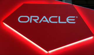 Oracle sign on a red background