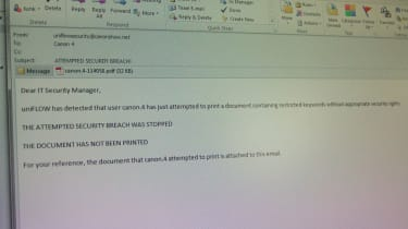 The email received by an administrator when someone tries to print a restricted document
