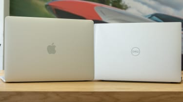 The Dell XPS 13 and Apple MacBook Pro 13in (2018) side-by-side with the lid open