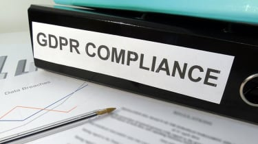 "A folder labelled ""GDPR Compliance"" on a desk"