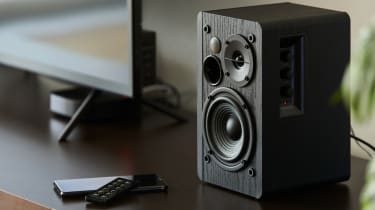 Black matted Bluetooth speakers on a desk