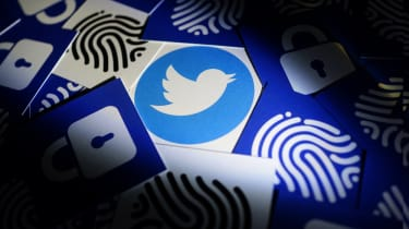 The Twitter logo on a card surrounded by other cards with images such as fingerprints and locks