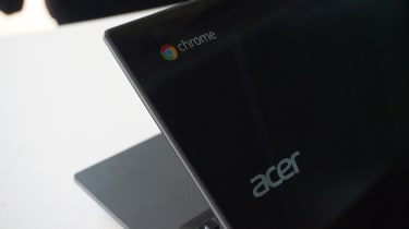 A close-up of the Acer and Google Chrome logos on the lid of the Acer Chromebook 14 for Work