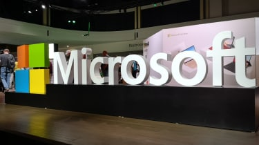 Large Microsoft sign on a show floor at Ignite 2019
