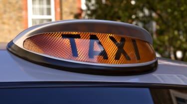 Black taxi cab sign