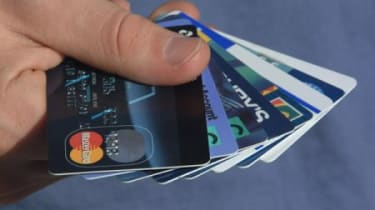 Hand holding an assortment of credit cards