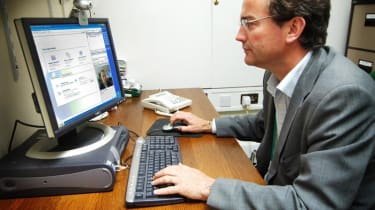 IT professional in front of a computer screen