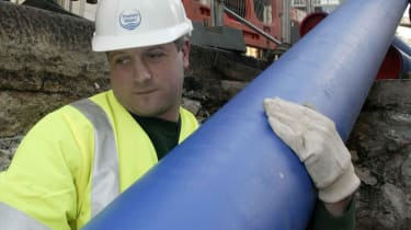 Man carrying a larger pipe