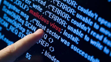 Finger pointing towards malware on a piece of code