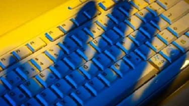 Hand casting a shadow over a keyboard