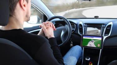 Man behind the wheel of a self-driving car