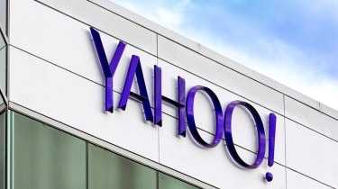 Yahoo! sign on top of a gray building