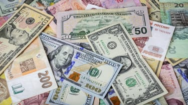 Money from different countries in a pile