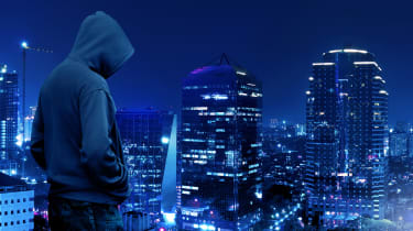 Hacker overlooking a city