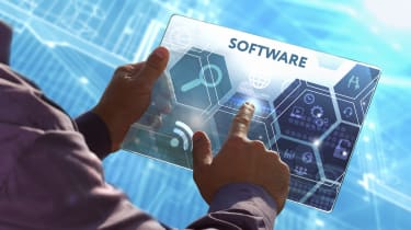 Man pressing a screen to choose software