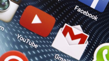 Gmail and YouTube icons on a smartphone screen