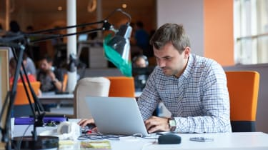 Man sitting behind a computer at an office
