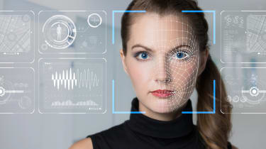 Woman having her face scanned