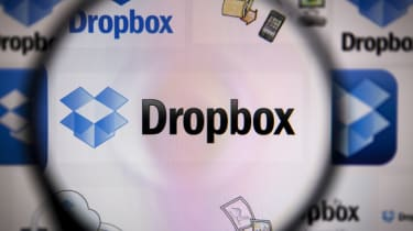 The Dropbox logo seen via a magnifying glass