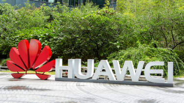 Huawei sign in front of green bushes