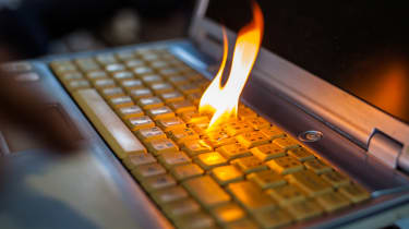 The keyboard of a laptop device having caught fire