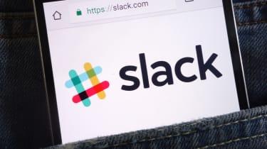 Slack logo on a smartphone display in a denim pocket