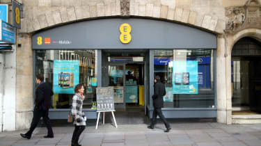 EE high street shop entrance with shoppers passing by