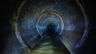 A dark sewer tunnel