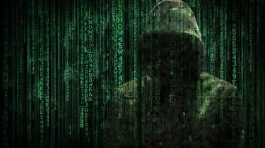 A concept image of a hacker behind a stream of binary