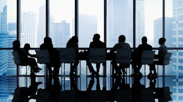 Board members round a table