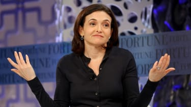 Sheryl Sandberg with hands up