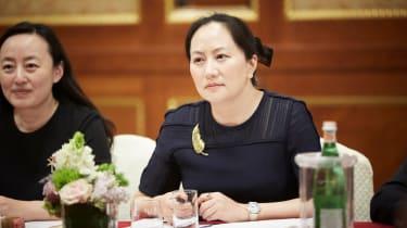 Meng Wanzhou at a table