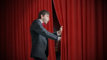 Man looking behind the curtain