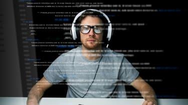 man reading computer code