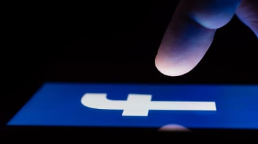 finger above Facebook icon