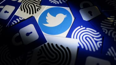 The Twitter logo as seen hidden among several other images including fingerprints