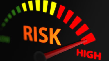 A meter showing levels of risk, with then needle landing on the 'high' section