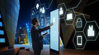 Man planning digital transformation on large mobile phone tablet