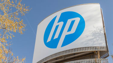 HP sign with a tree and blue skies in the background