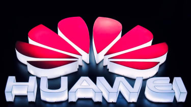 The Huawei logo in lights
