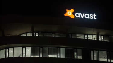 Avast building at night with the lighted sign turned on