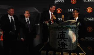 Sir Alex Ferguson looks on as Epson and Manchester United seal the deal with a ceremonial sake ritual