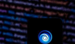 Image of the Ubisoft logo appearing on a phone before lines of code